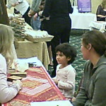 A young sage with a reader at the Holistic Healing Expo